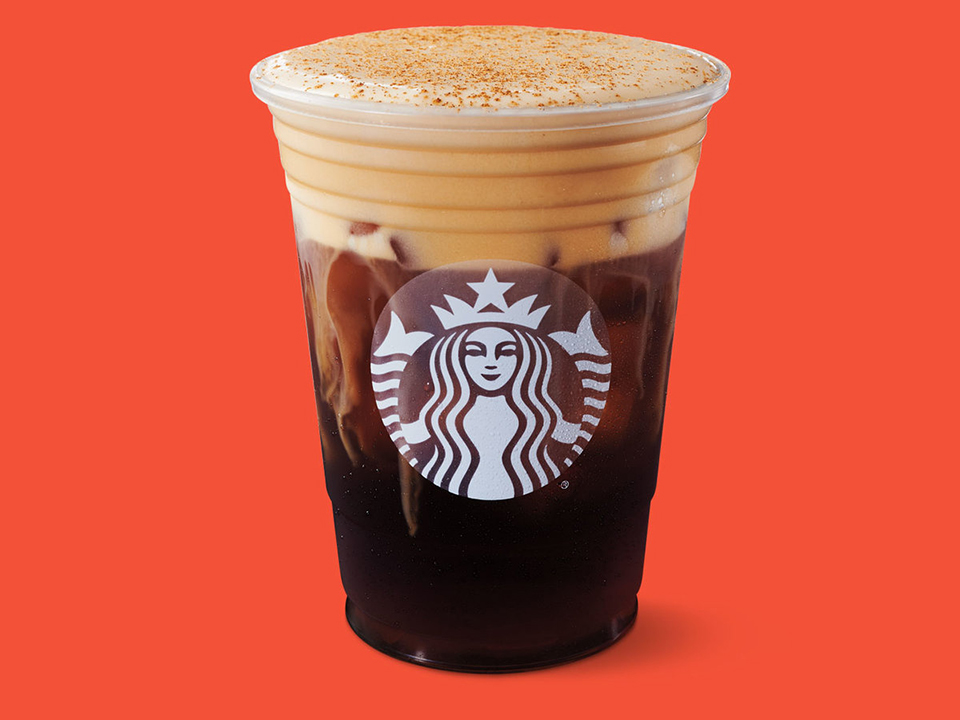 Starbucks branded cup of cold brew coffee on ice with delicious foamy cream at the top